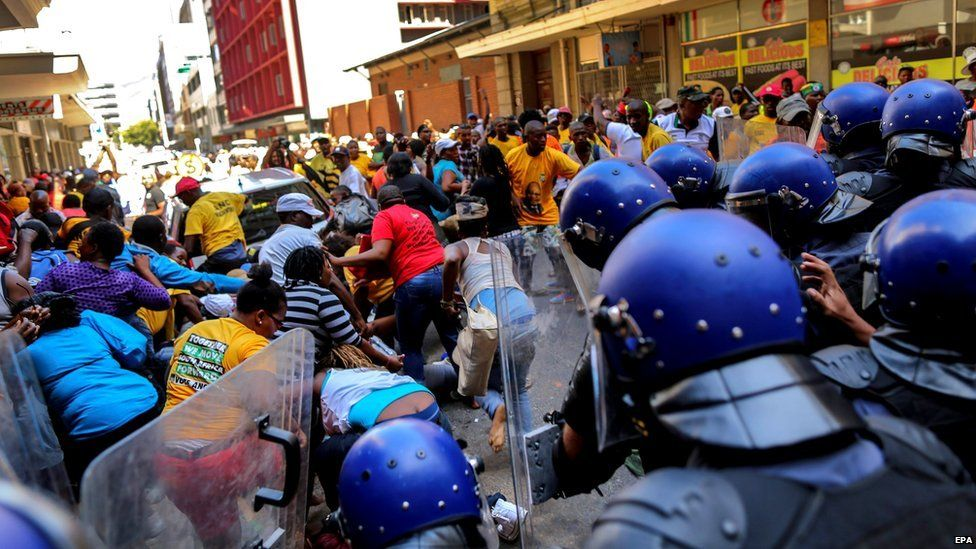 South African protestors clash with police ahead of the opening of parliament ceremony in Cape Town