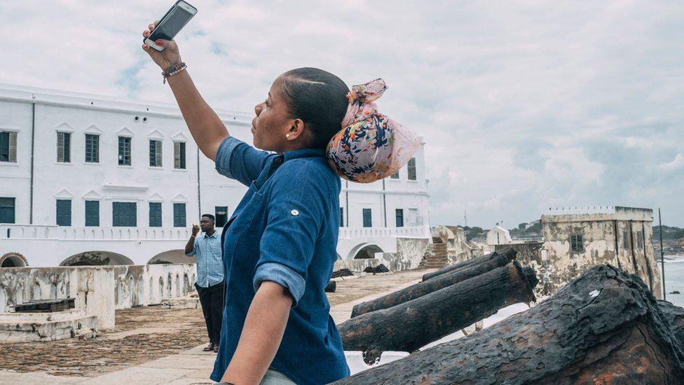 A tourist takes a selfie at the Cape Coast Castle on August 18, 2019