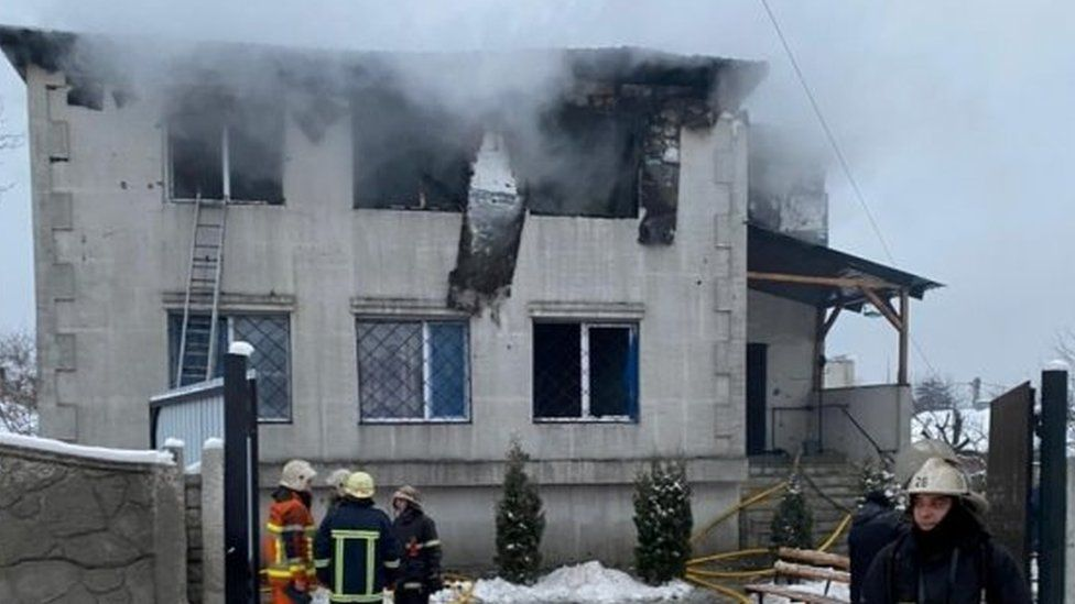 Ukrainian firefighters tackle a blaze at a house for the elderly in Kharkiv. Photo: 21 January 2021