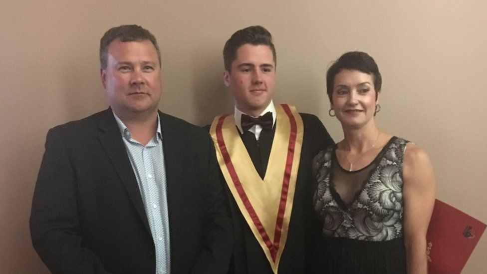 Evan Thomas between his two parents