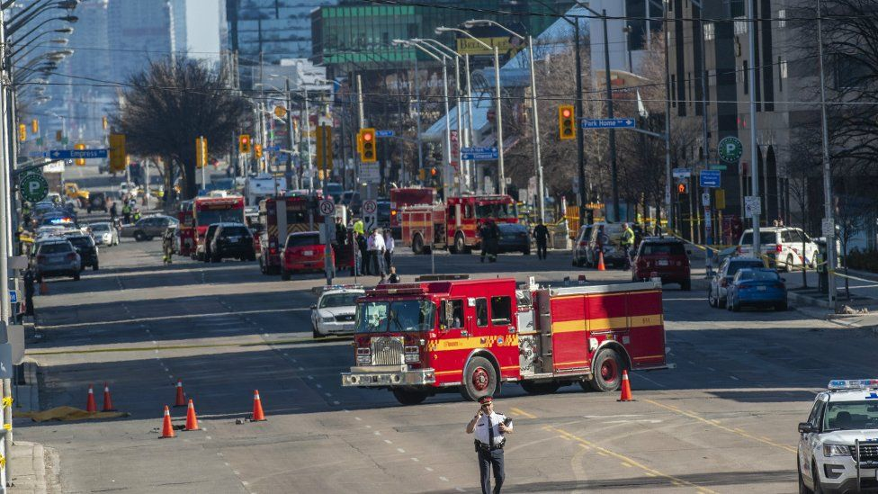 Toronto police and emergency crews can be seen along Yonge Street in northern Toronto, Canada, 23 April 2018