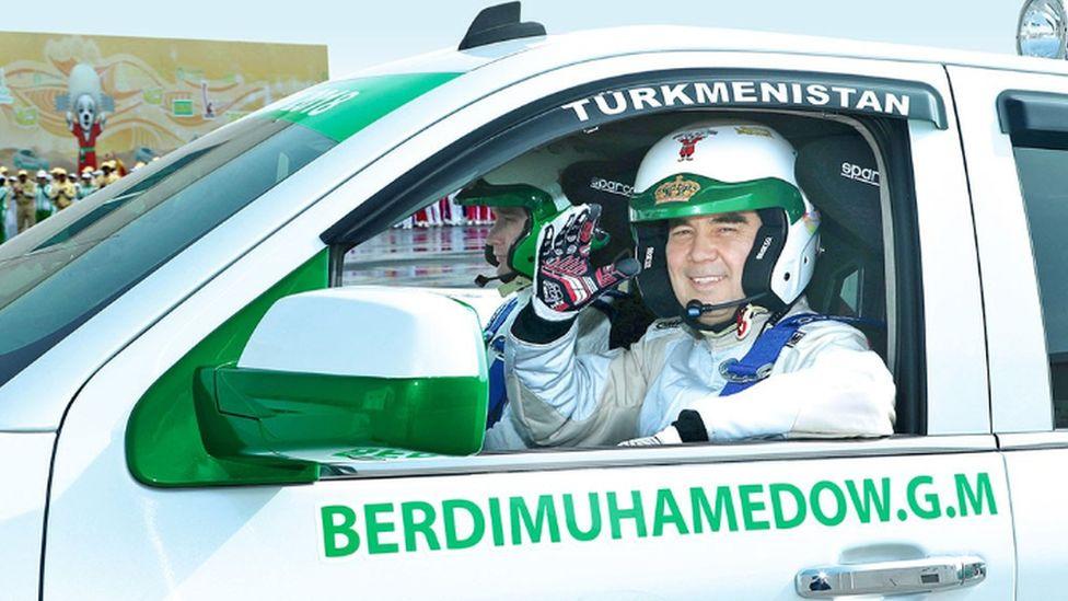 Turkmen President Gurbanguly Berdimuhamedow at the wheel of a rally car