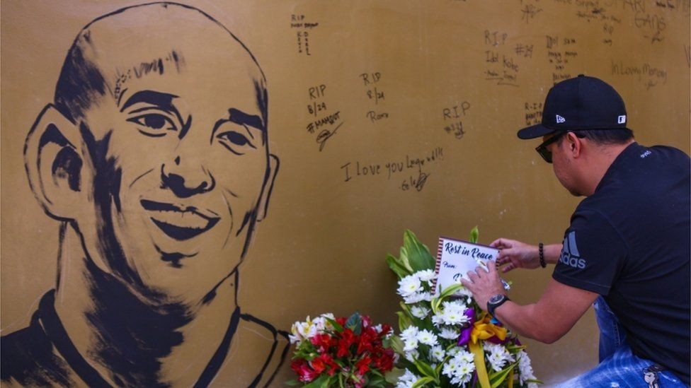 A wall covered in tributes to Kobe Bryant in Manila