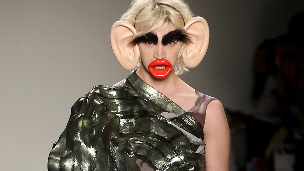 A model wearing accessories such as large ears, large lips and large eyebrows, which has been labelled 'racist'.