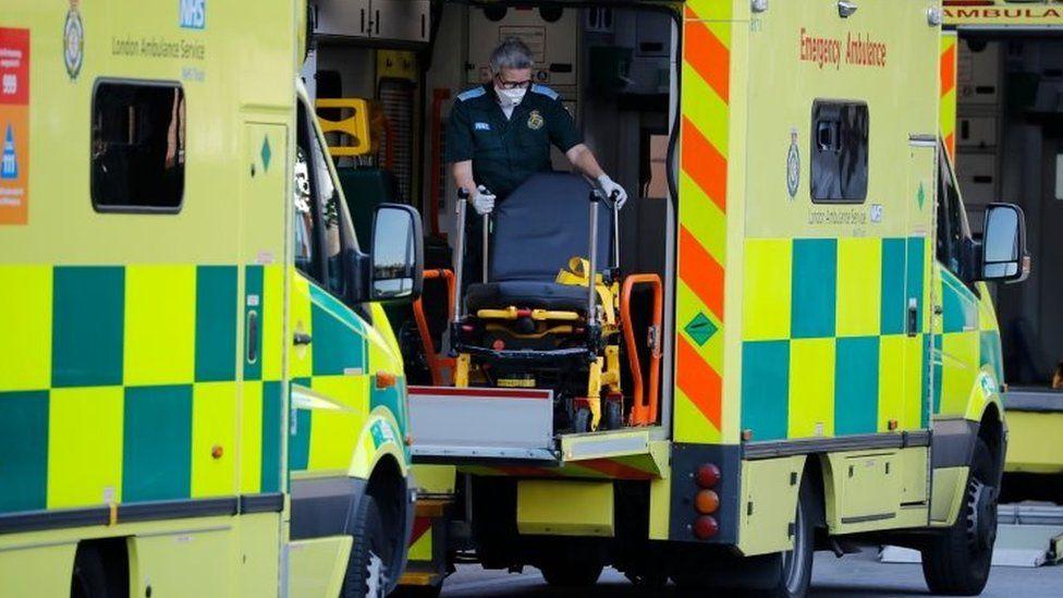 Paramedics wearing PPE outside the Royal London Hospital in east London