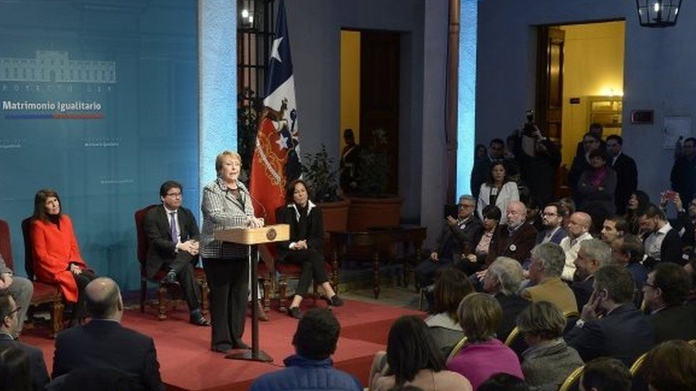 A handout photo made available by the Presidency of Chile shows Chilean President Michelle Bachelet as she presents a bill she signed today to guarantee marriage equality, at La Moneda Palace in Santiago, Chile, 28 August 2017