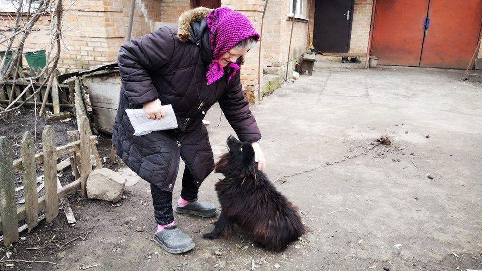 Lyubov Kolyucha and her dog Sharik