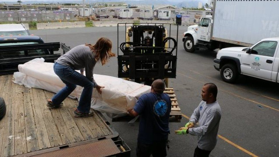 The sign being removed from a truck, to be flown to Japan