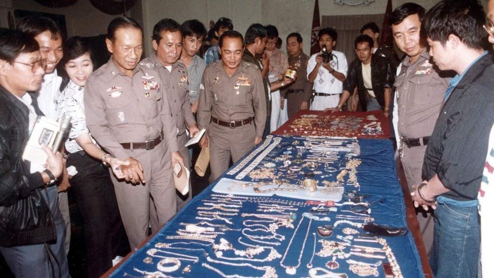 Thai police with stolen jewels