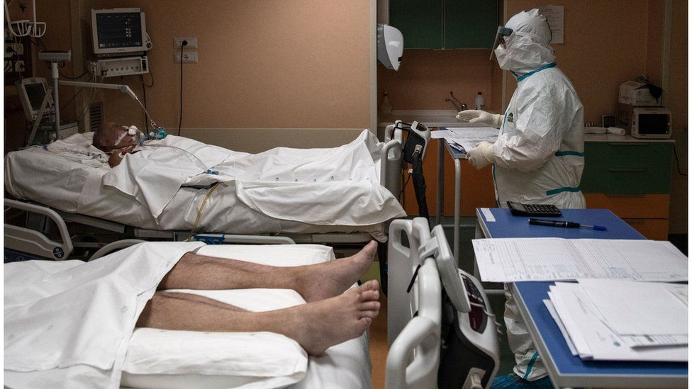 A doctor attends to patients in intensive care in the Covid-19 ward of the Maria Pia Hospital in Turin on 7 April 2020.