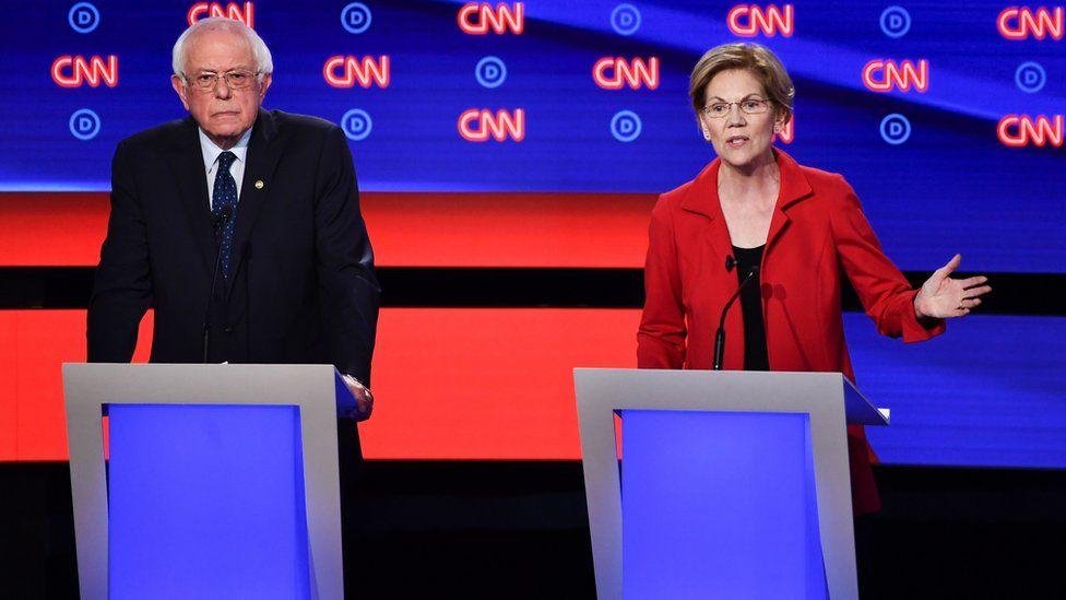 Bernie Sanders and Elizabeth Warren pictured at a debate
