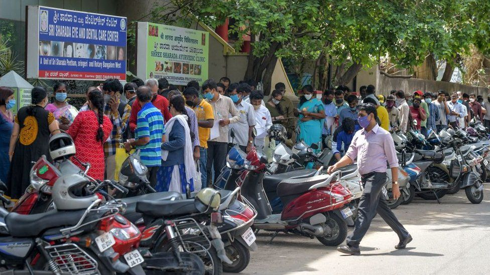People queue up outside a hospital in Bangalore