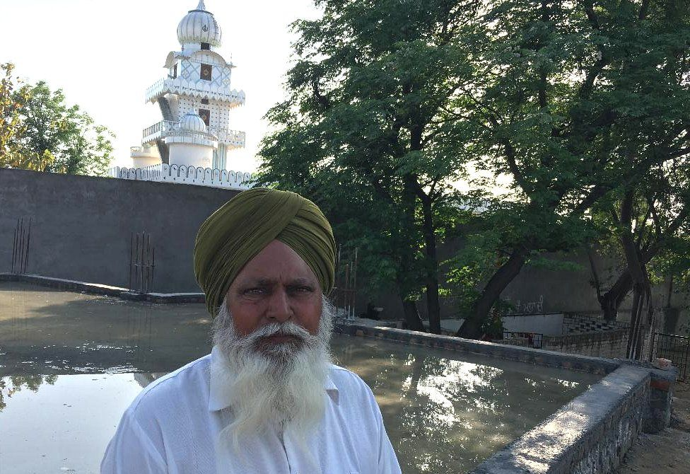 Villager Chood Singh in front of the gurdwara