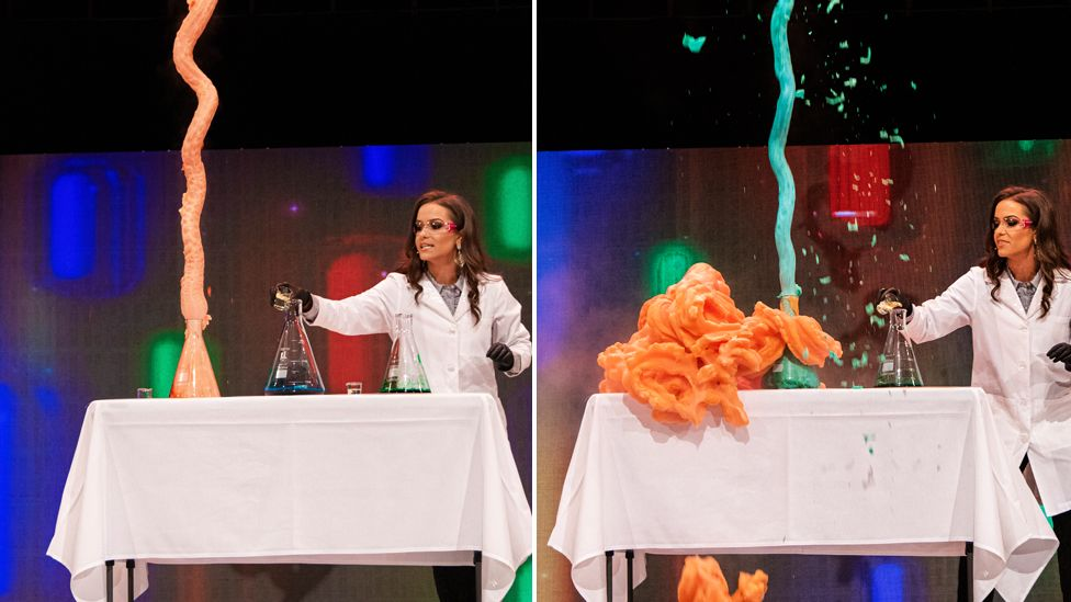 Camille Schrier in the middle of her experiment on stage