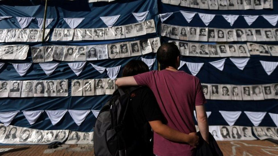 People in Buenos Aires stand next to pictures of those who went missing during Argentina's military rule. Photo: 30 April 2017