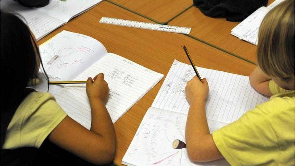 School pupils practising spelling