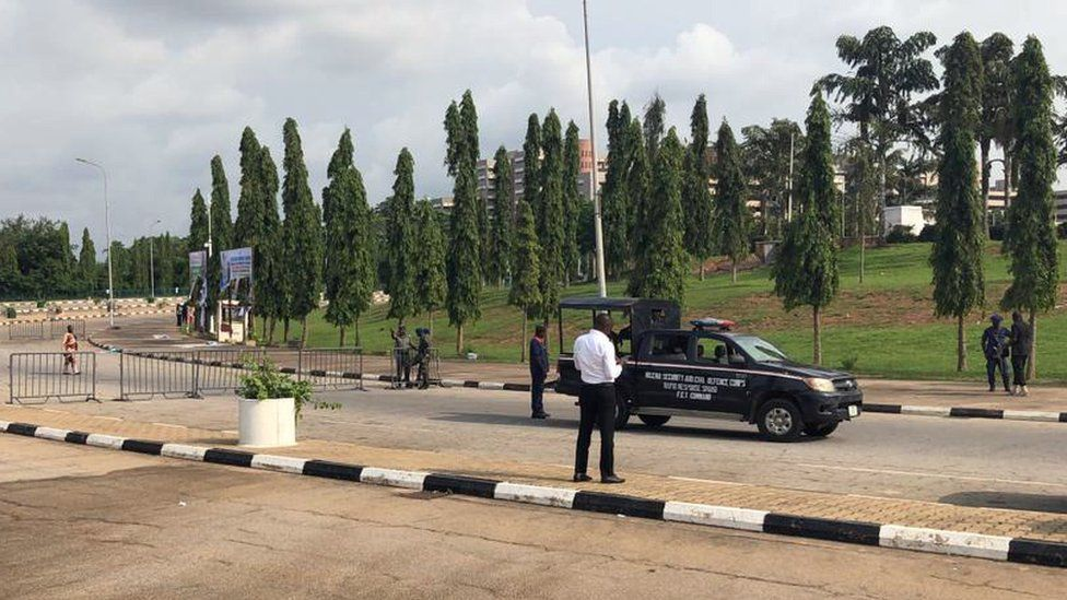 Members of security forces secure the area outside the National Assembly in Abuja