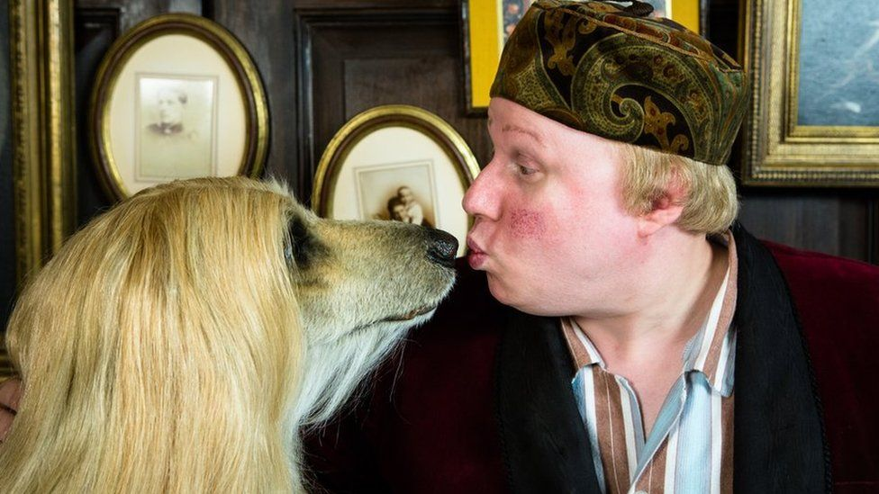Matt Lucas puckers up with a dog as part of his BBC series Pompidou