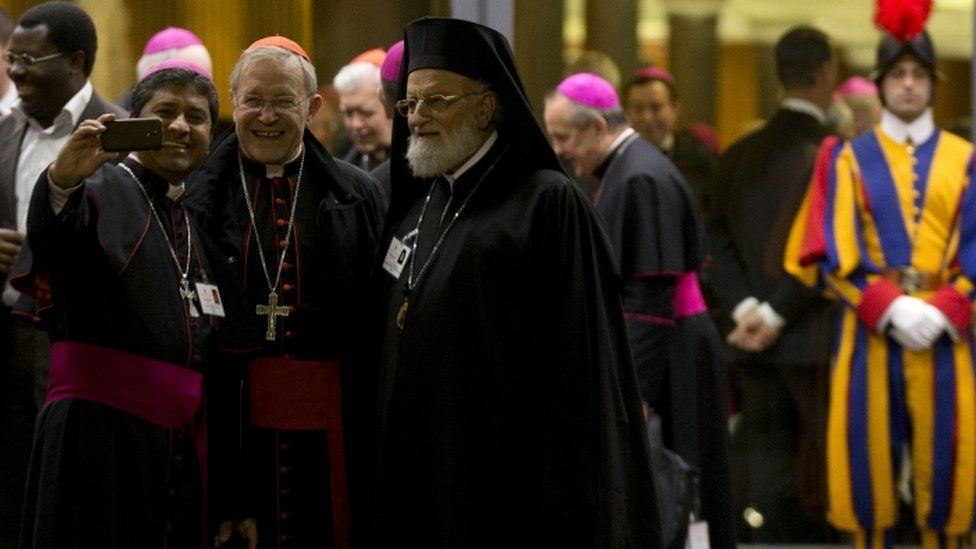 Bishops take a selfie at a meeting of the synod in the Vatican