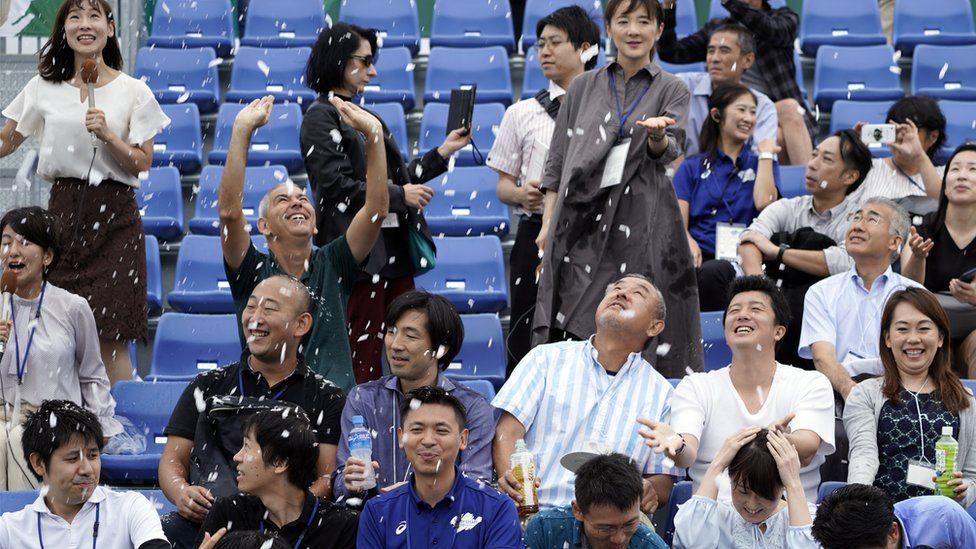 Spectators enjoying the summer snow