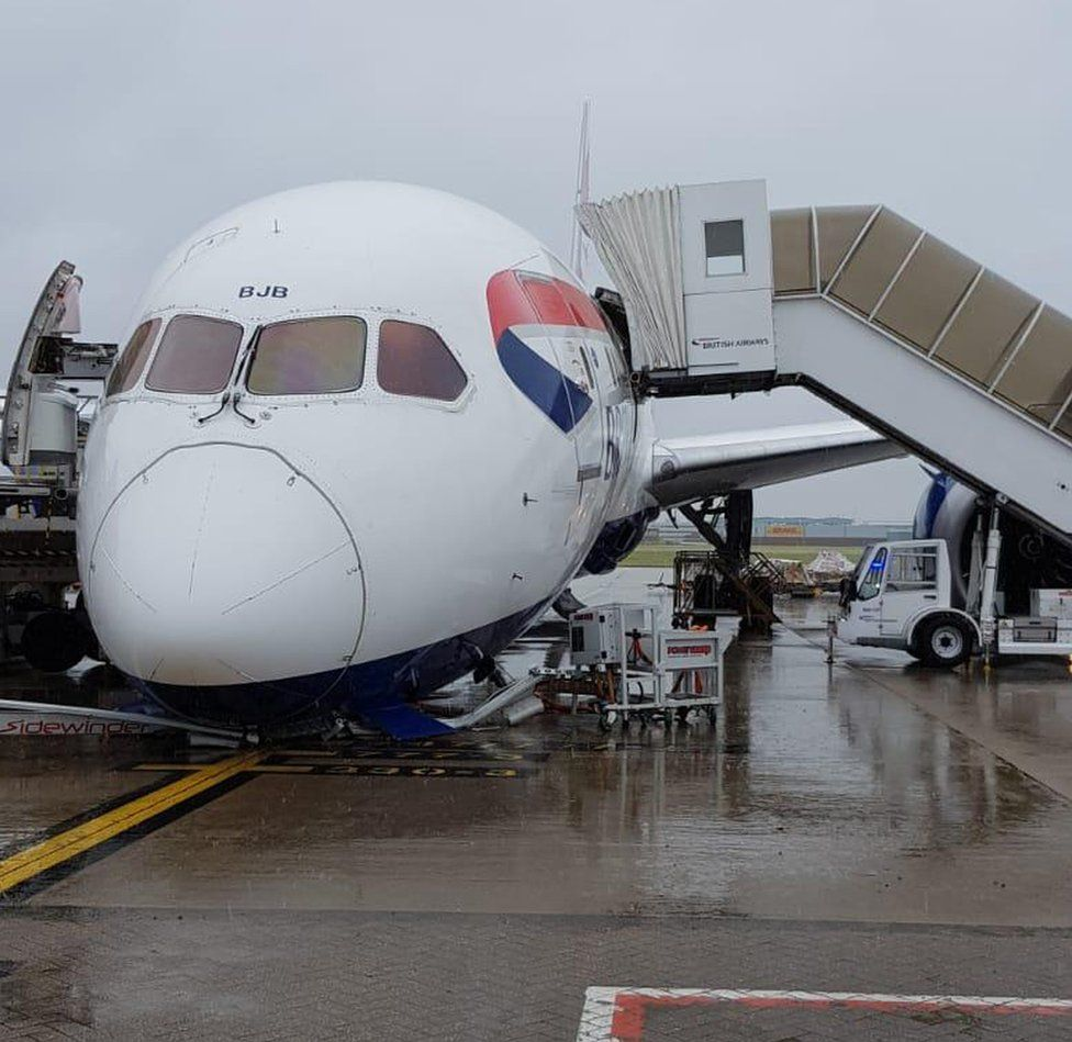 BA plane with nose tipping forward