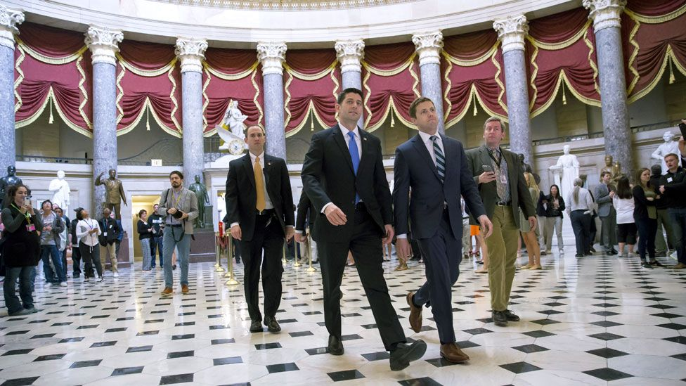 House Speaker Paul Ryan walks to chamber