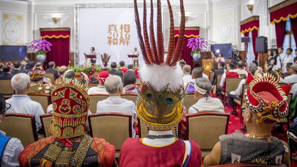 """Representatives, dressed in traditional clothing, from some of Taiwan""""s 16 recognised indigenous tribes, attend a ceremony inside the Presidential Office building in Taipei on August 1, 2016"""