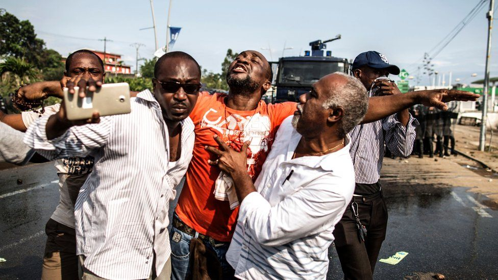 A Ping supporter is carried away during clashes with police