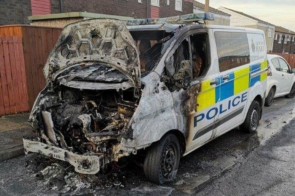 The fire-damaged Cleveland Police van