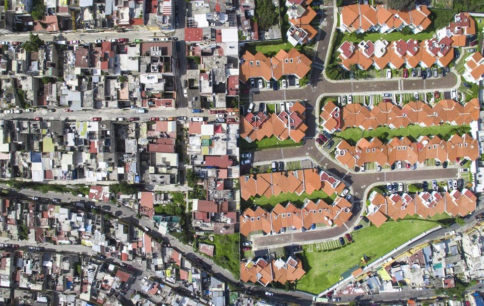 Aerial shot showing the contrast between rich and poor neighborhoods in Santa Fe, Mexico City, Mexico.