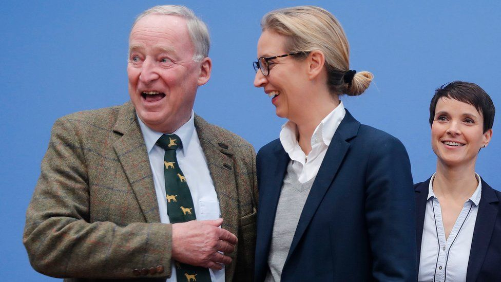 Frauke Petry (R), chairwoman of the anti-immigration party Alternative fuer Deutschland (AfD) poses next top candidates Alice Weidel and Alexander Gauland (L) before a news conference in Berlin, Germany, September 25, 2017