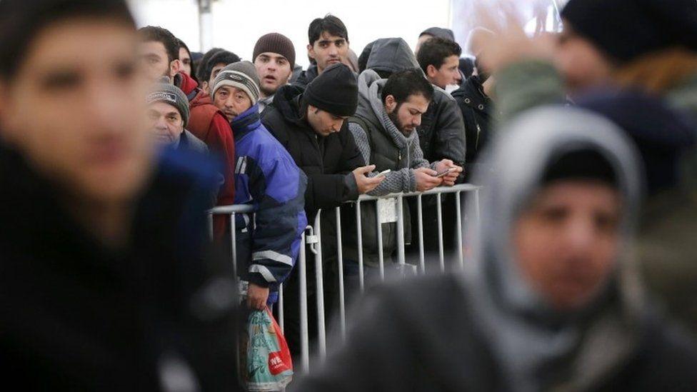 Migrants queuing to register in Berlin