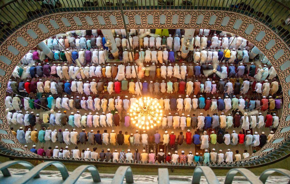 Muslims attend Eid al-Adha prayers