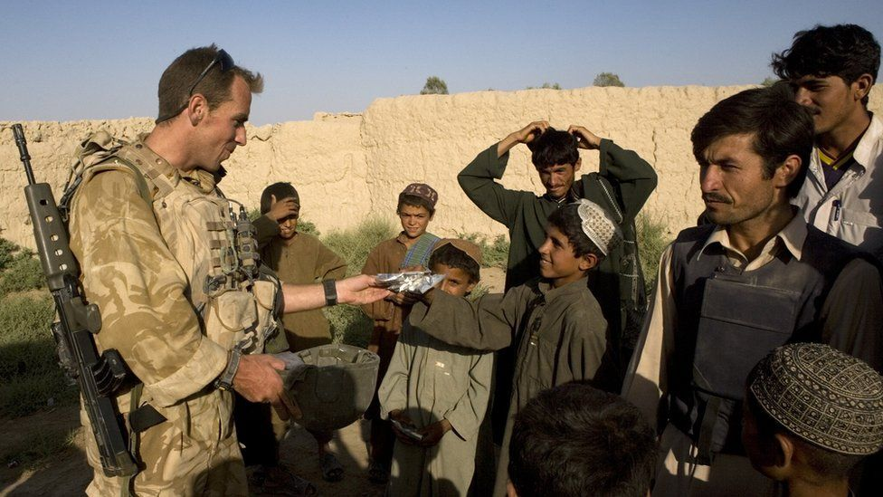A British soldier meets Afghans