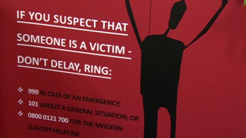 Modern slavery poster appealing for public assistance