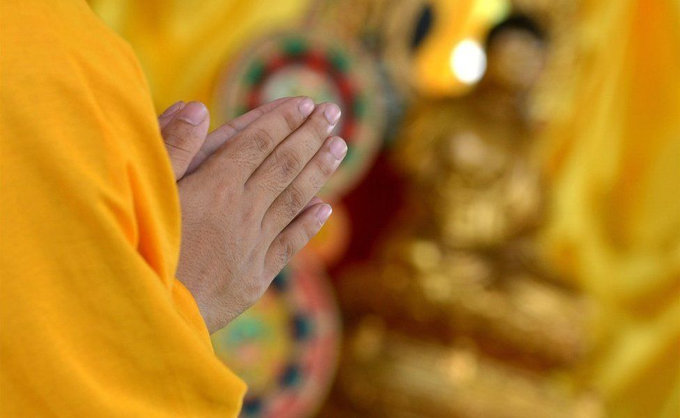 A Chinese Buddhist monk prays during a day of special prayers at the Quirino Grandstand in Manila on 9 August 2014
