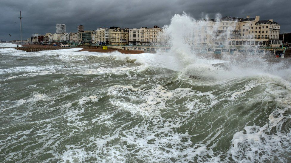 Waves crash on the shore at Brighton beach, England. Photo: November 2018