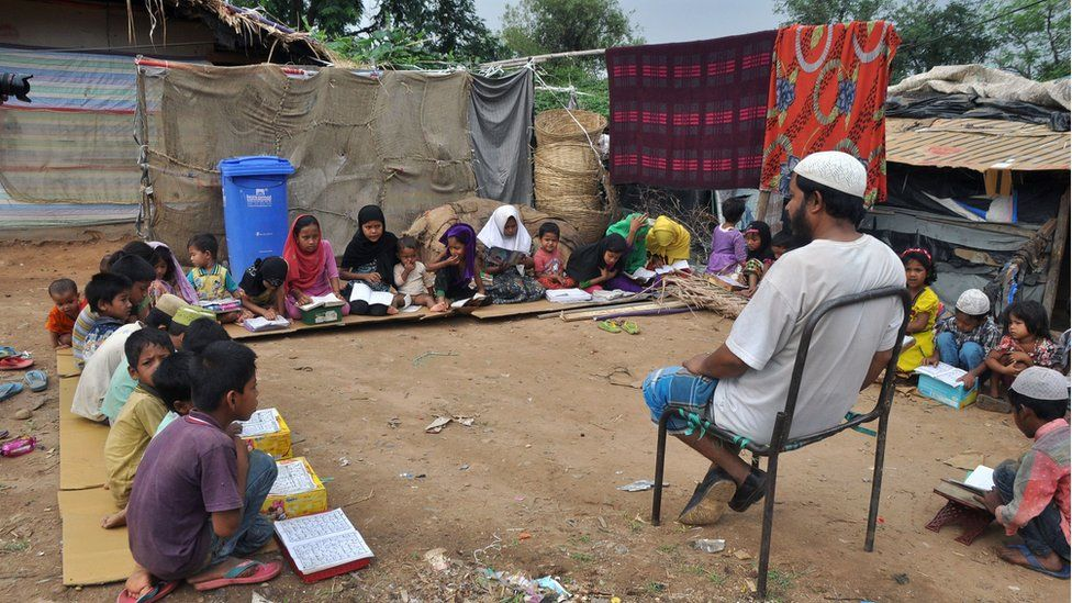 Rohingya Muslim refugee children from Myanmar study at a makeshift madrasa (religious school) on World Refugee Day in the outskirts of the Indian city Jammu on June 20, 2017.