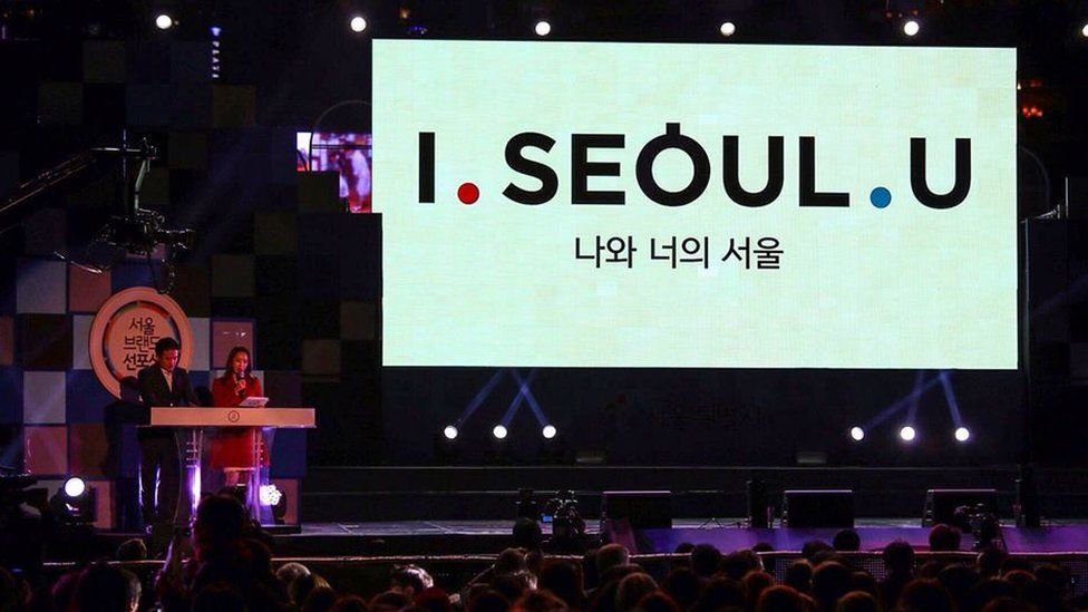 The slogan on a big screen at the even announcing the winner