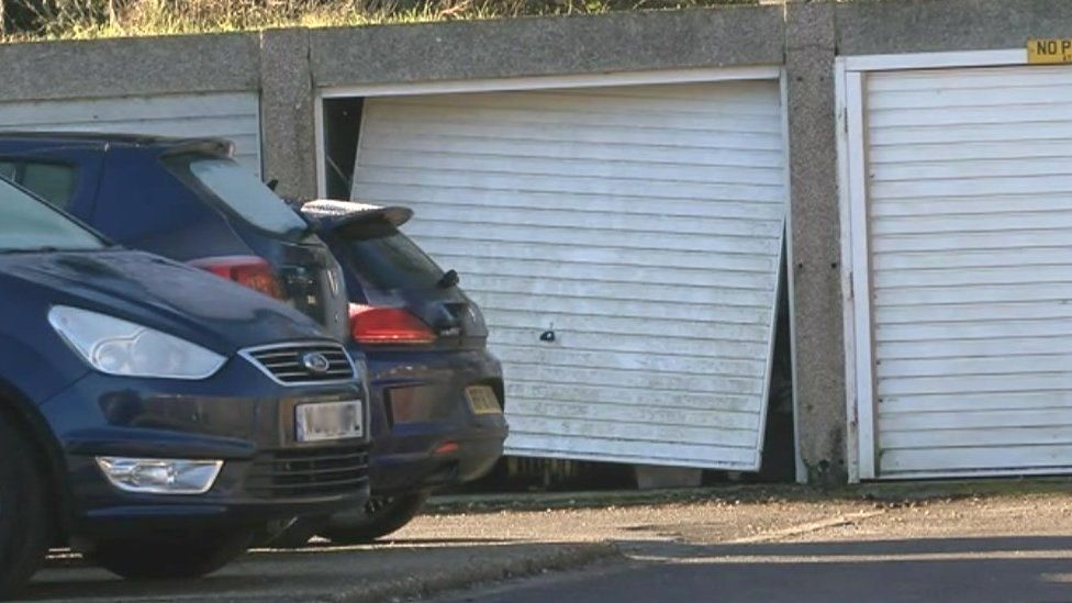 The shooting took place at a block of garages