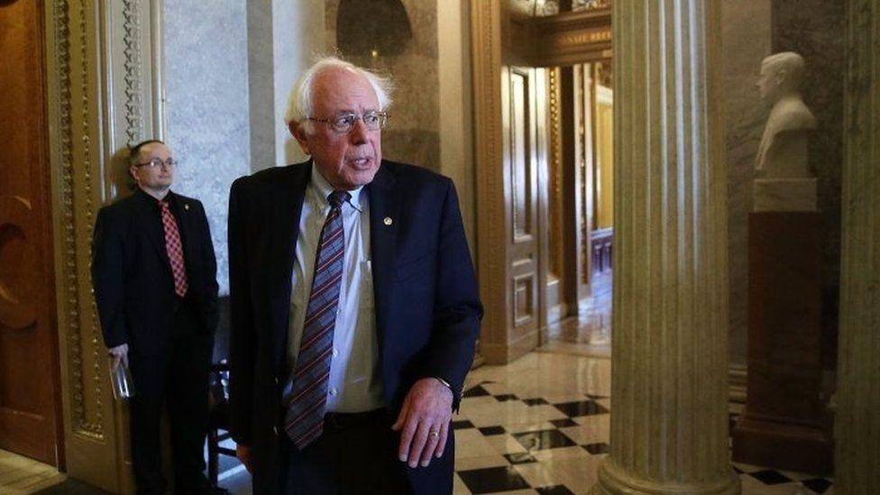Senator Bernie Sanders leaves the Senate chamber on 1 December