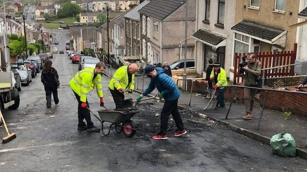 Swansea council workers and the community begin the clean-up