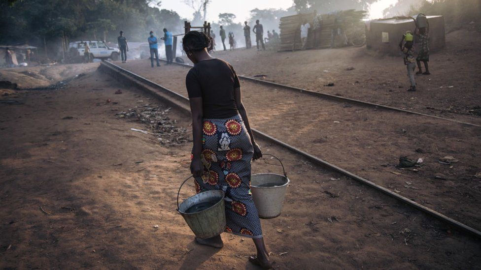 Central African refugee woman carried water to the refugee site at Ndu, Bas-Uele, DRC on 21 January 2021