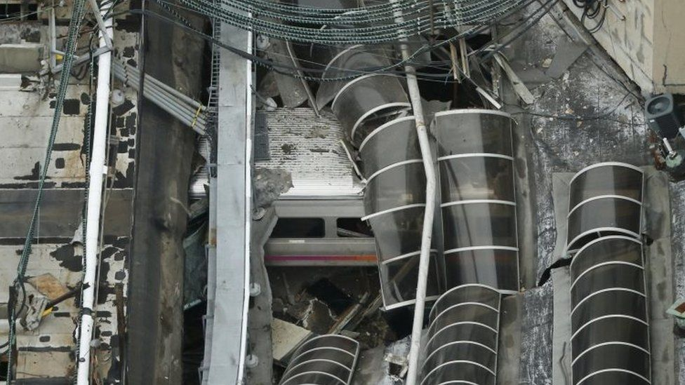 A derailed New Jersey Transit train is seen under a collapsed roof after it derailed and crashed into the station in Hoboken, New Jersey, U.S