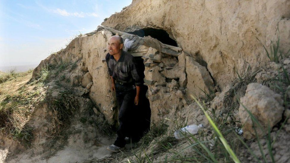 This photo taken on May 24, 2021 shows shepherd Zhu Keming, hailed as a hero in China for rescuing six ultramarathon runners when extreme weather hit the area leaving at least 20 dead, showing the cave dwelling where he sheltered the stricken athletes near the city of Baiyin, in China's northwestern Gansu province.