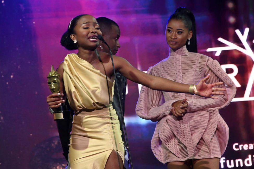 Ditebogo Ledwaba receiving her award on stage in Johannesburg, South Africa.