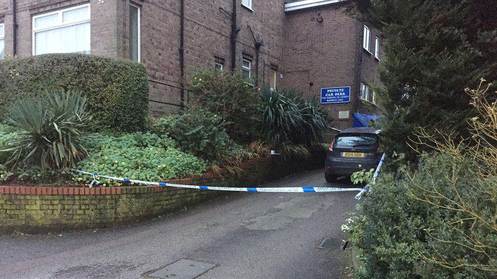 Police tape by church car park