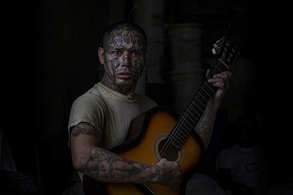 An inmate and former La 18 gang member plays the guitar at the Penal San Francisco Gótera, El Salvador. November 8, 2018.