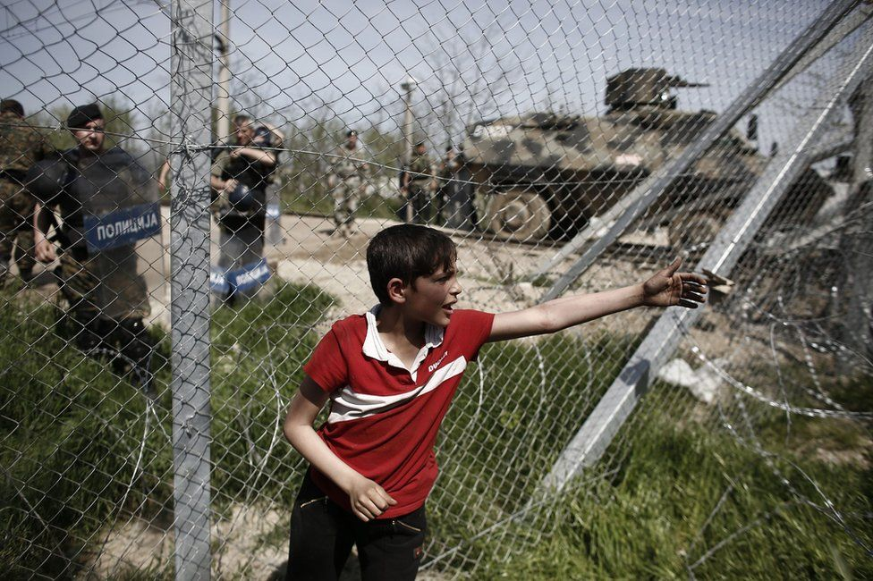A boy protests at Greece's border with Macedonia, 7 April