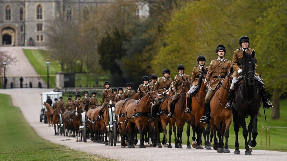 "Members of the King""s Troop Royal Horse Artillery ride along the Long Walk transporting three guns as preparations take place ahead of Britain""s Prince Philip""s funeral ceremony outside Windsor Castle, in Windsor, Britain,"